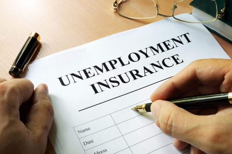 Unemployment insurance form on a table.